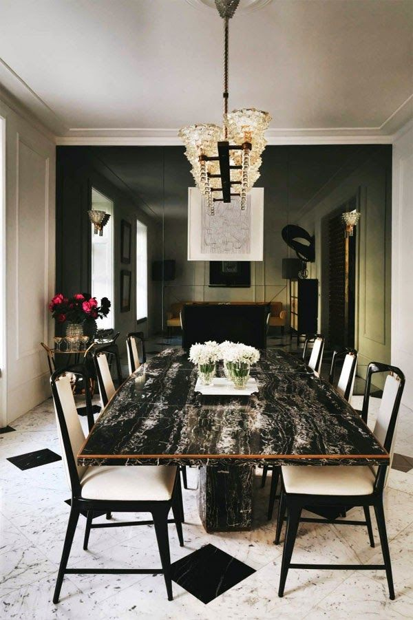 black mirrored wall with a black marble table and black chair frames rh pinterest com