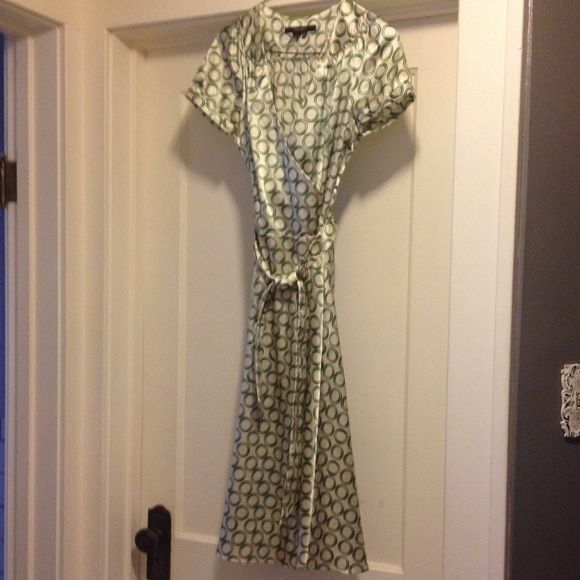 """Silky dress """"wrap"""" style From Zara this cream and green silky dress crosses across chest and ties at waist. Side zip. 27in waist. Size small Zara Dresses"""