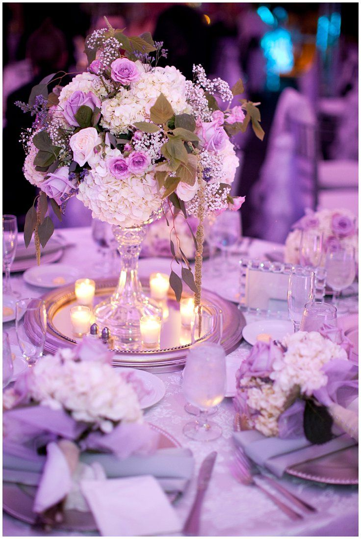 Mini chandelier style centerpieces with purple roses and white mini chandelier style centerpieces with purple roses and white hydrangea elegant fall wedding reception aloadofball Choice Image