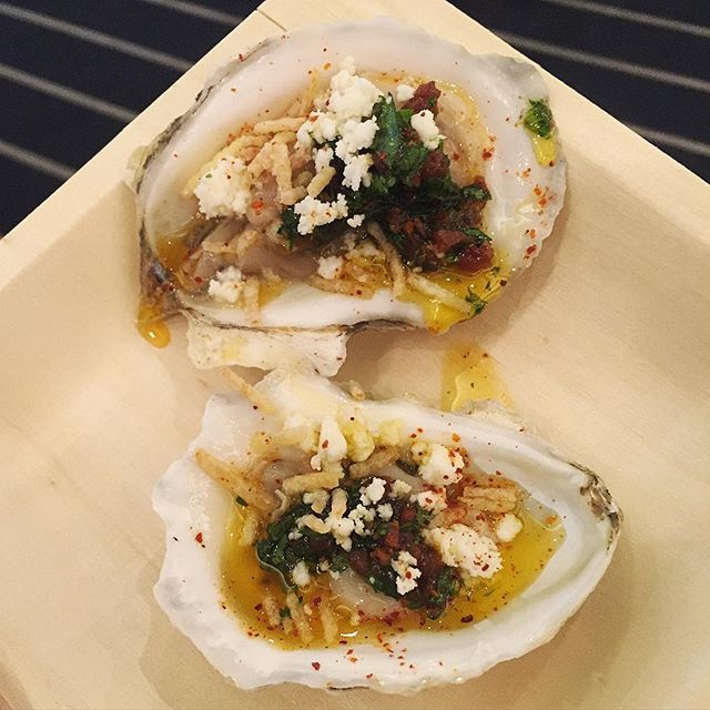 Oyster Bash at #SOBEWFF is no joke. Pictured: Oysters with Chorizo Salsa Verde and Queso Fresco from Izzy's Fish & Oyster. These marinate in chorizo fat overnight. ( @gearedtocook) by foodnetwork
