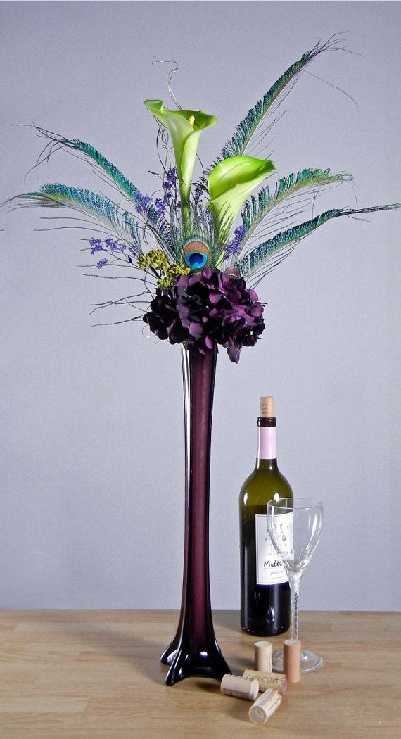 Peacock feathers green calla lilies and purple hydrangeas