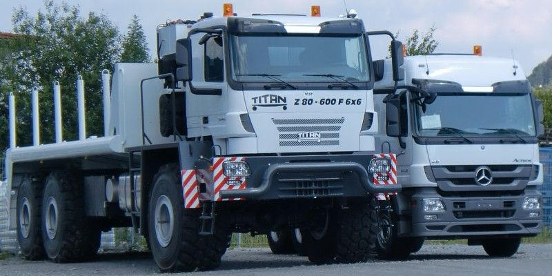 Awesome Titan Z80-600F truck near a Mercedes Actros 6x6