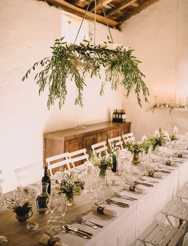 Wedding Reception Decor With Hanging Greenery via