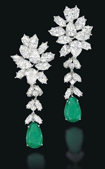 50eb76840 A PAIR OF EMERALD AND DIAMOND EAR PENDANTS Of foliate design, the pear- shaped emerald suspended from a detachable diamond line to the pear and  marquise-cut ...