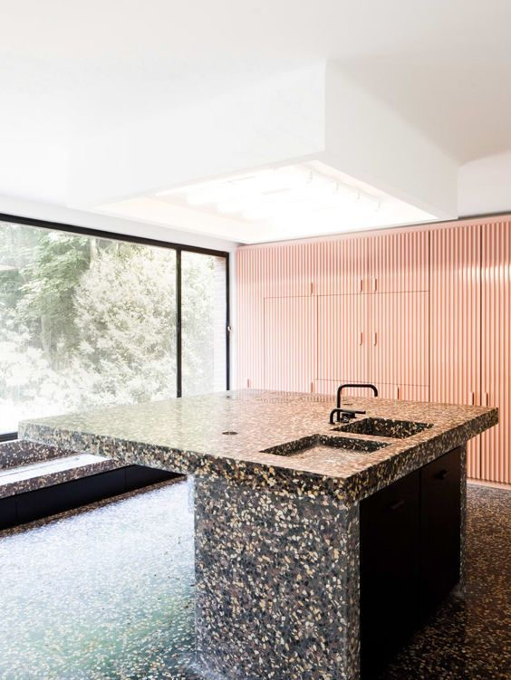 dark terrazzo kitchen island and floor look like a monolith rh pinterest com