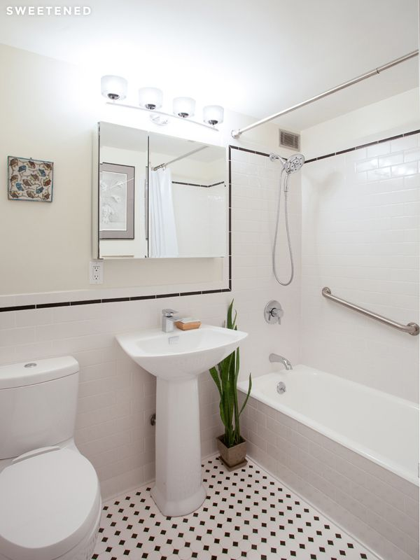 modern bathroom designs%0A Clinton Hill allwhite bathroom features a cast iron tub  grab bar for  shower  and Toto sink and toilet