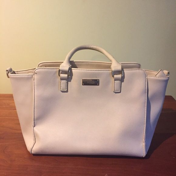 BCBG purse BCBG Paris cream purse. Zipper pocket on both the in and outside. Body: 100% polyurethane Lining: 100% polyester. Used daily for about two months, normal signs of use BCBG Bags Totes