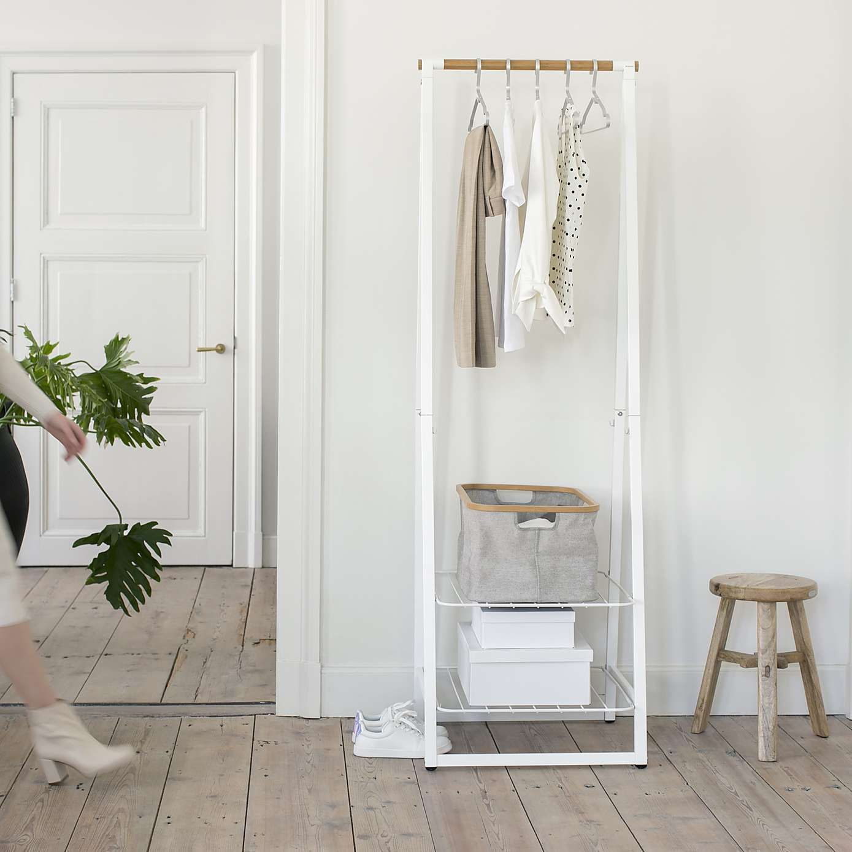 white linen indoor clothes rack
