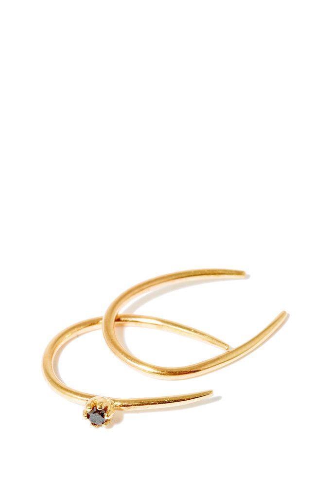 Sarah & Sebastian delicate 14k yellow gold Stone Aura Hoop earrings features a circular open mismatched pair with a singular black diamond setting. Handmade