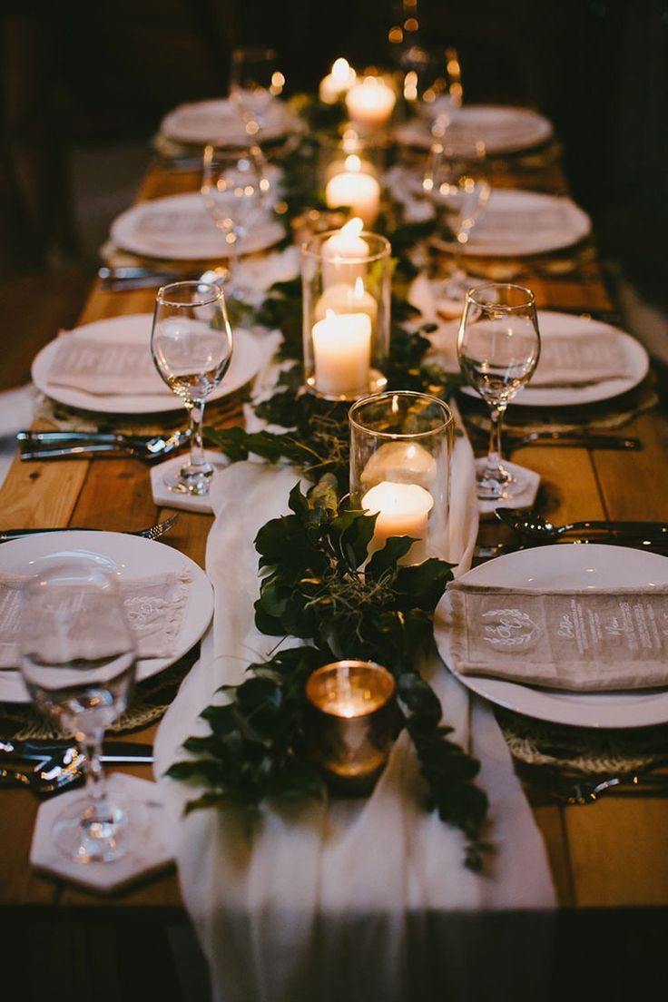 Rustic candlelit wedding reception centrepiece with foliage