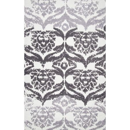 Define an area in the den or add a pop of pattern to the master suite with this lovely rug, showcasing a damask-inspired motif in grey.