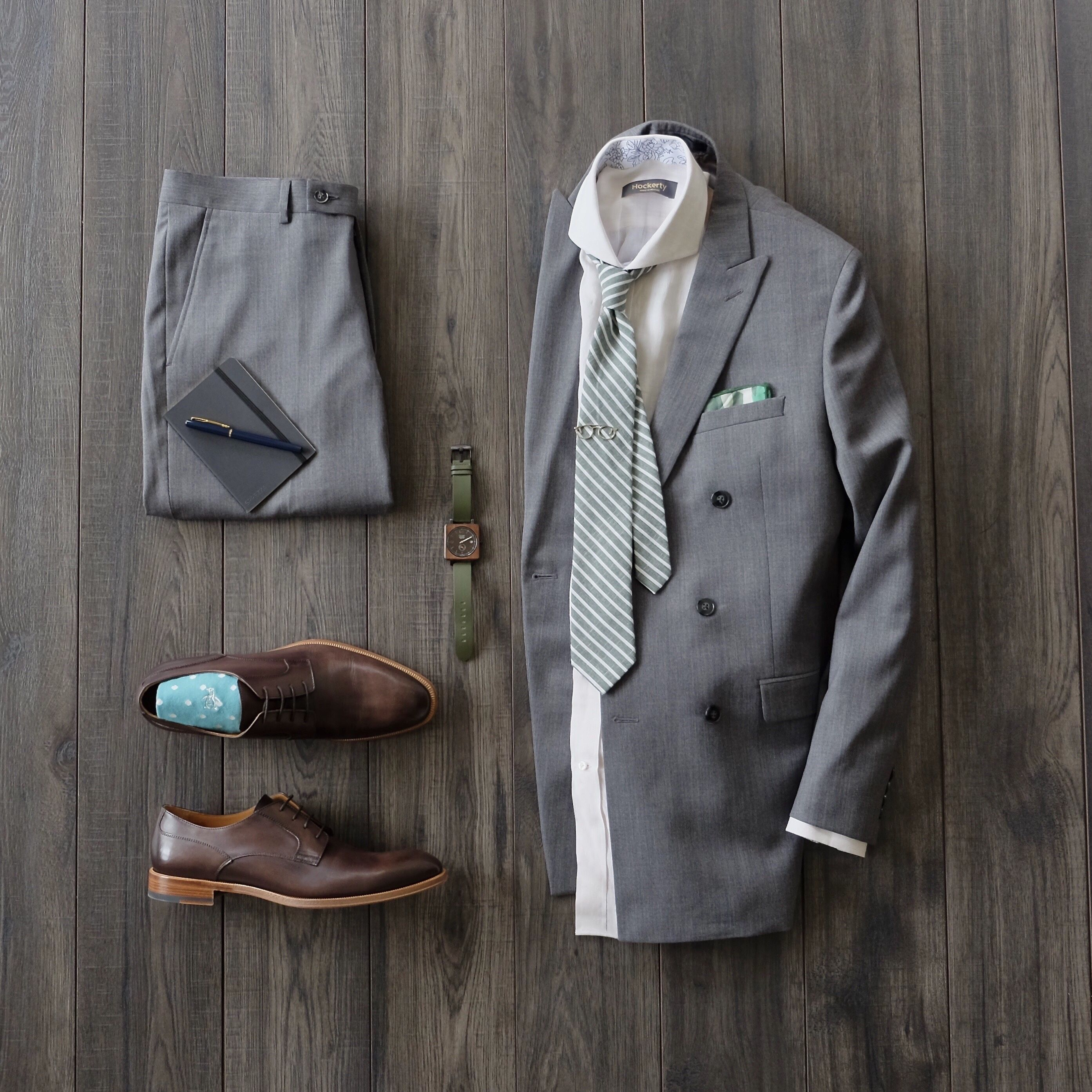 Double breasted suit inspiration with a green striped tie aqua socks