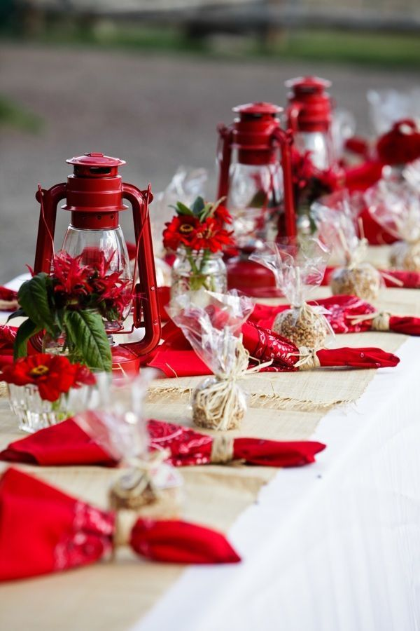 Outdoor table setting with red bandanas as table napkins and red lamps #vintage #vintagewedding #weddingreception #outdoorwedding #red