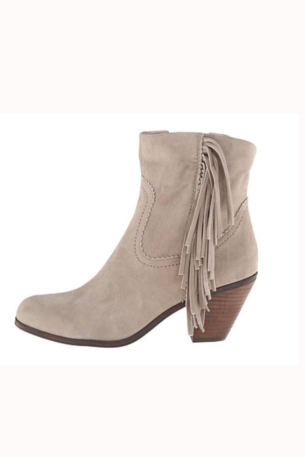 3cdd27aabeeaa This soft suede grey bootie features a zip closure on the inseam and fringe  detail on