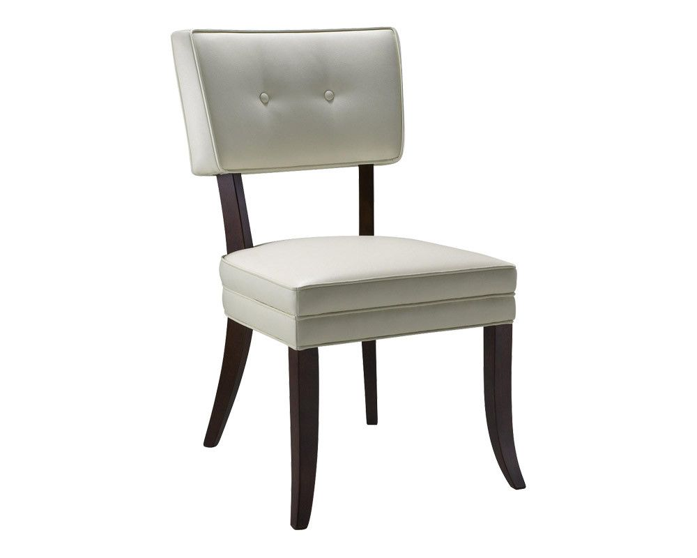 This gorgeous slightly over-sized Amelia Dining Chair features an open back and two stylish buttons. Stocked in ivory bonded leather with an espresso frame
