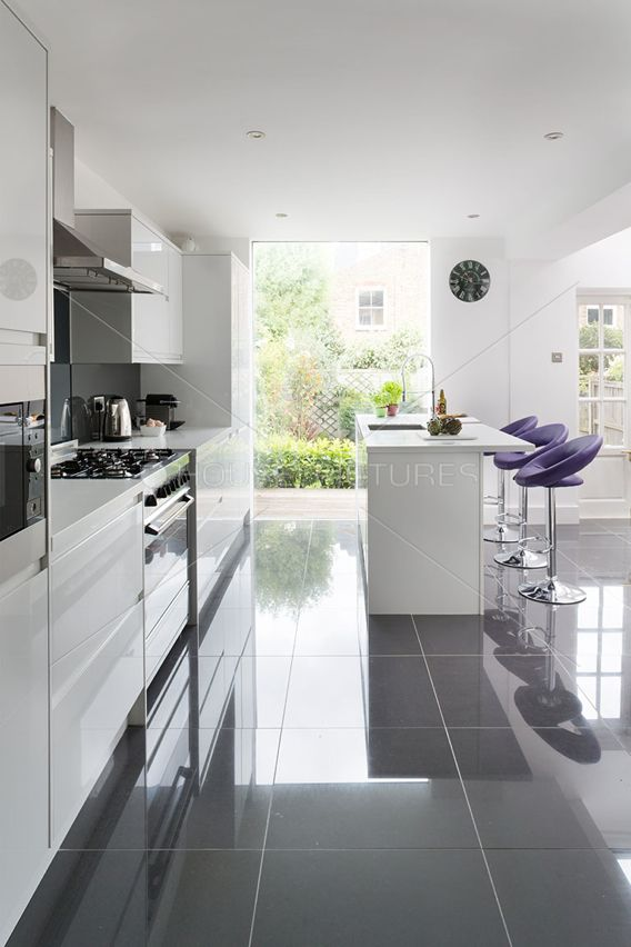 u201cThis simple squared kitchen design is brought