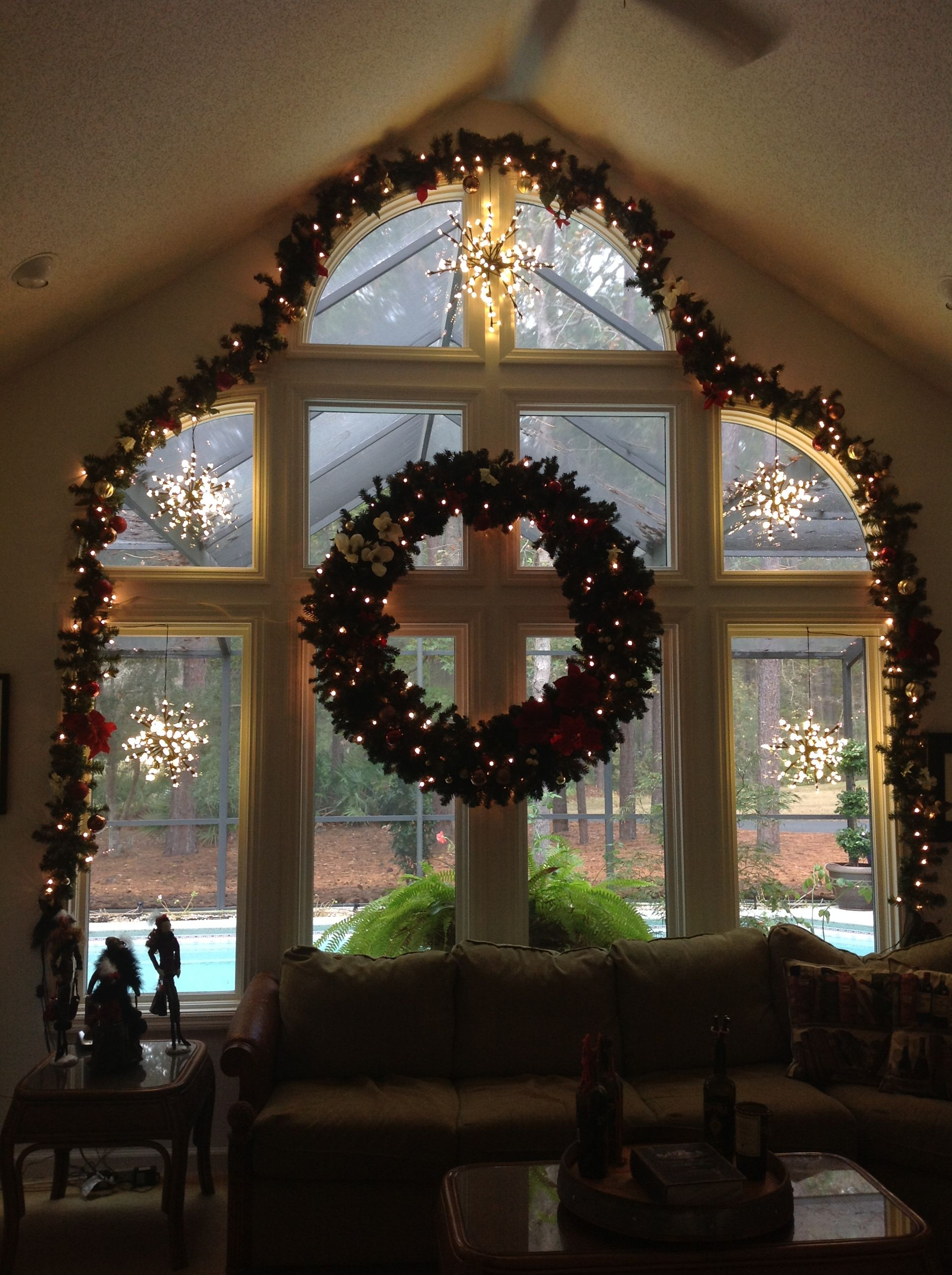 Decorate a large window with garland silk flowers and