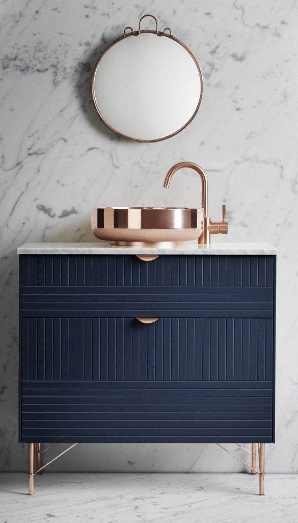 copper bathroom sink marble floor wall tiles navy vanity blue cabinet with