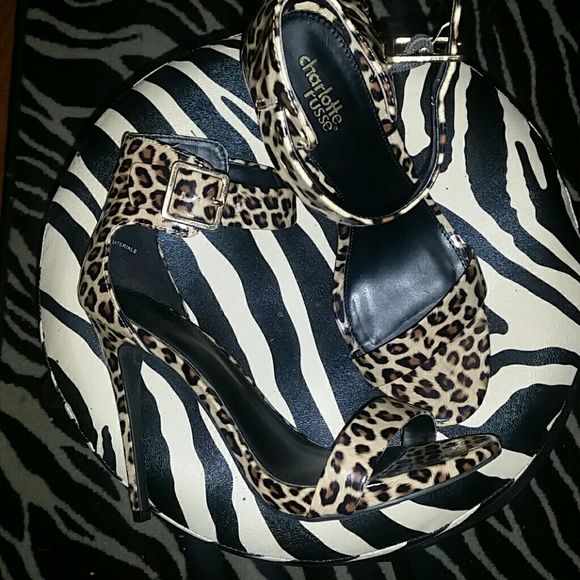 Brand new Charlotte russe Leopard print Brand new without box Charlotte russe barely there heels in a size 8 im cheetah print.  Shoe is narrow for those with wide feet dont recommend. Heel height 4.5 inches ......they are BEAUTIFUL. I sell cheaper on Ⓜercari just let me know! :) Charlotte Russe Shoes Heels