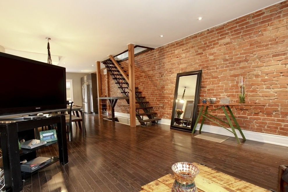 Tall baseboards on exposed brick wall Tall