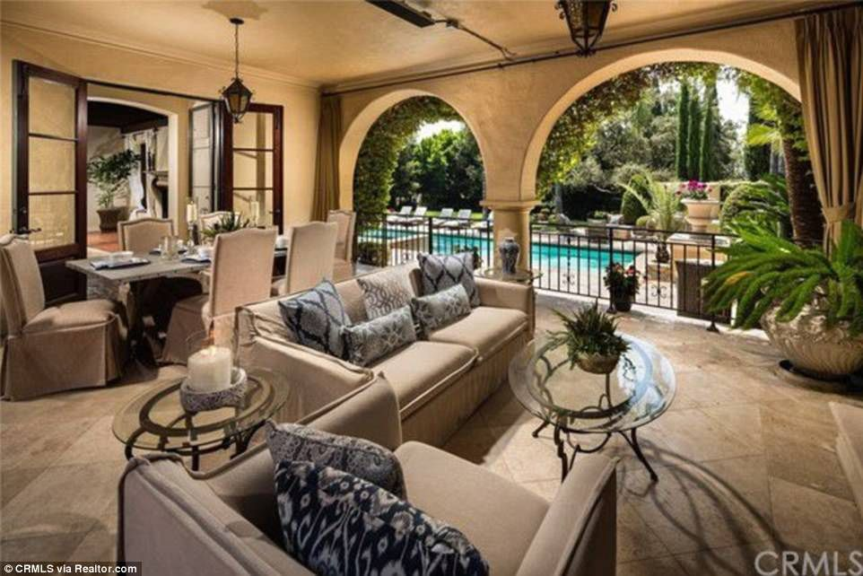 TV host Nancy O'Dell lists Mediterranean mansion for 7