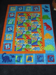 http://www.sassyquilters.blogspot.co.uk/#   Lovely dinosaur themed quilt
