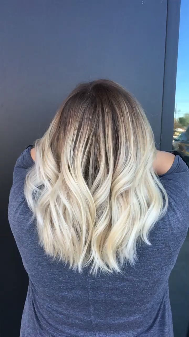 Blonde balayage dark roots with bleach blonde ends medium length