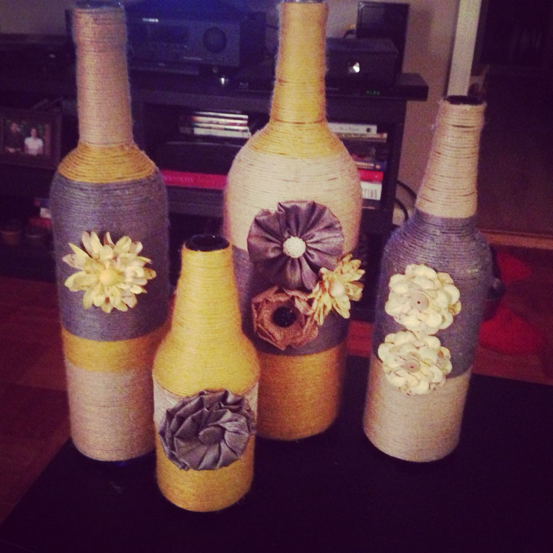 After 4 weeks, I am so happy with how these turned out! Wine bottles, beer bottles, wine, scrapbook aisle flowers and yarn. So fun!