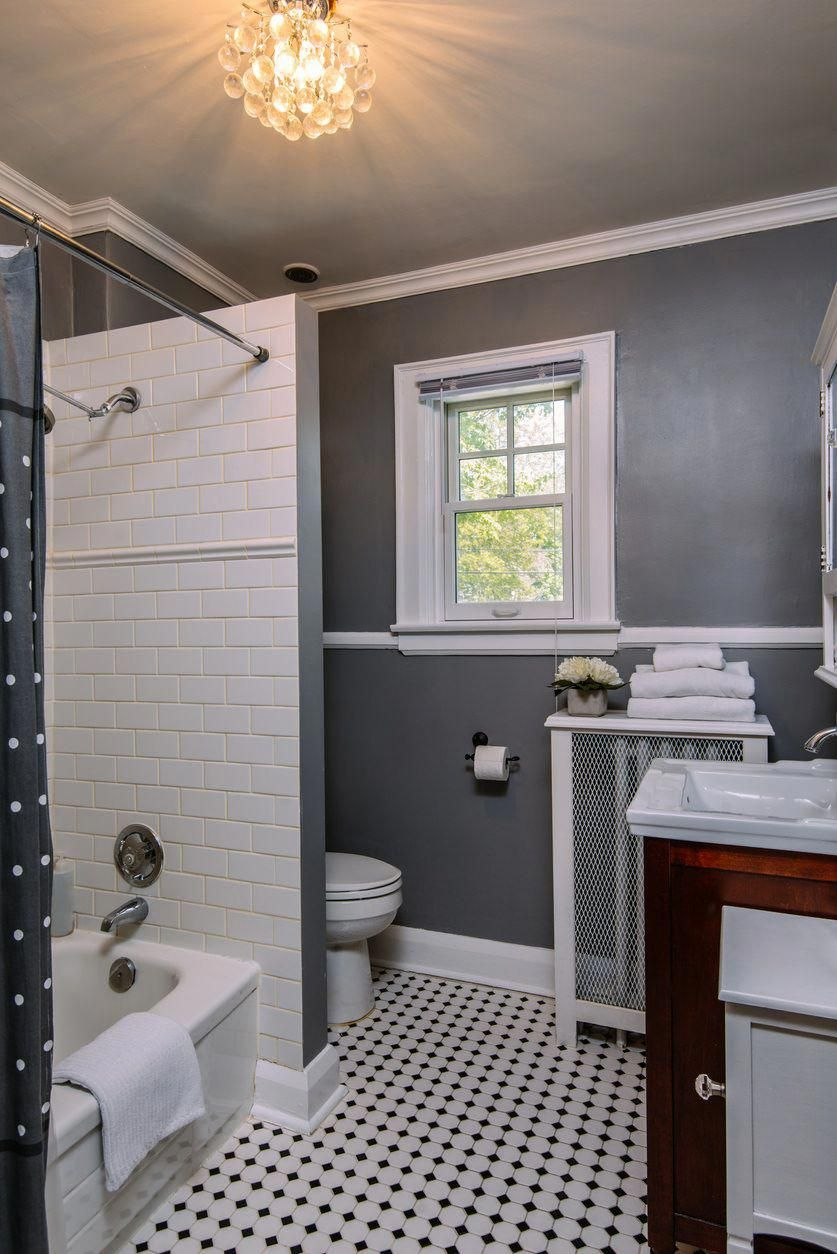 decorated in white tile shower gray painted walls and a