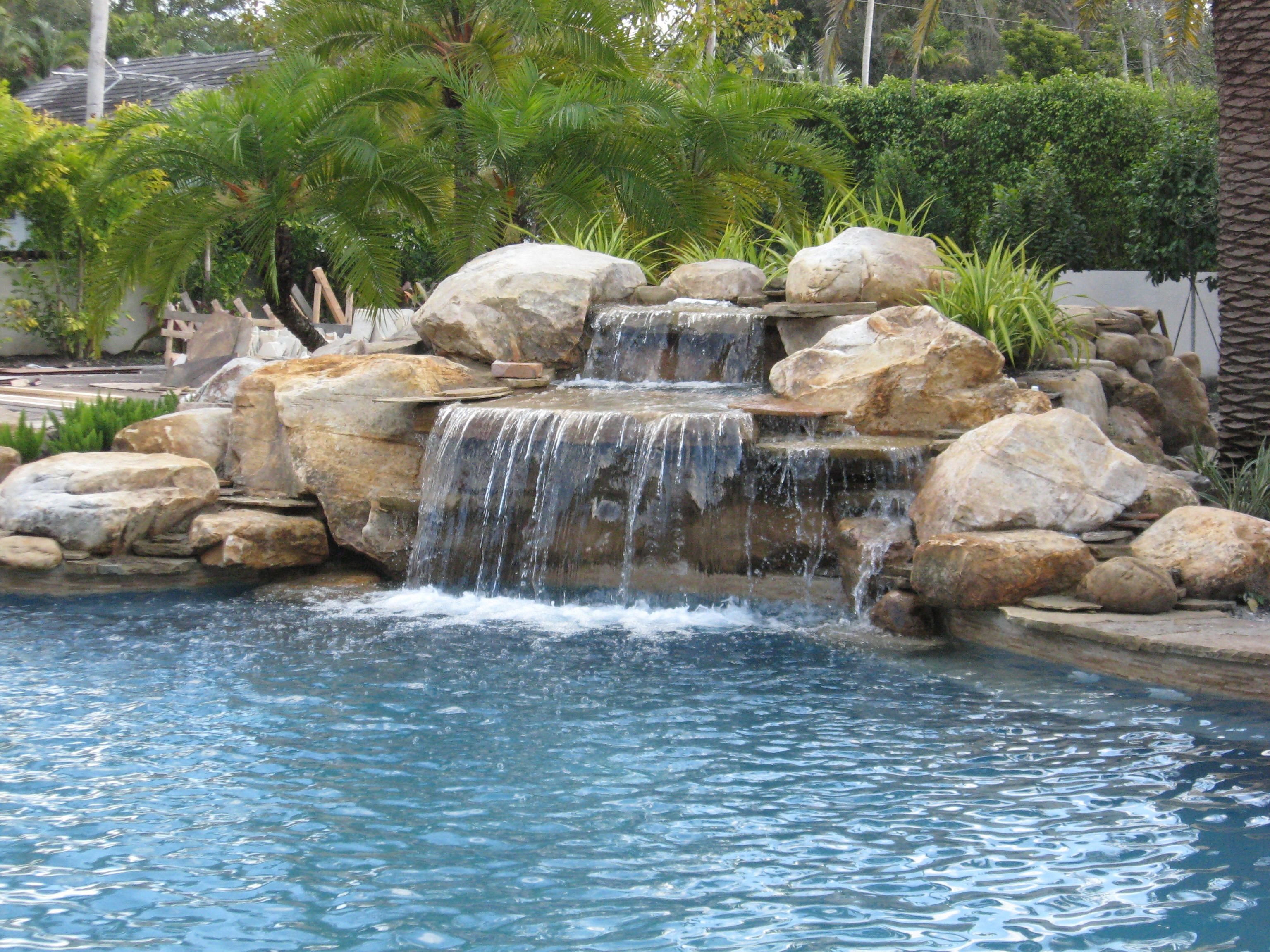 Luxury pools stone walk in pool w beach sand luxury for Waterfall fountain