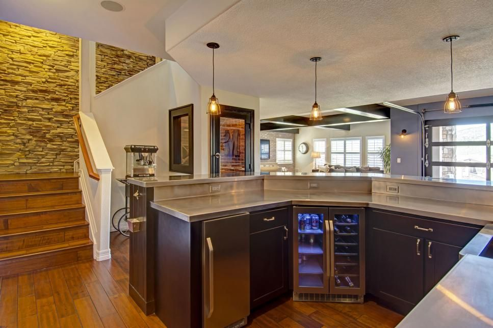 this spacious basement was renovated to include a wet bar with rh pinterest com