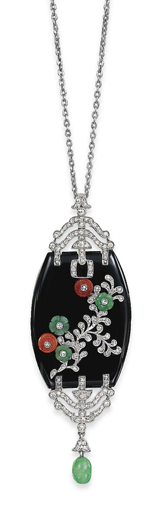 AN ART DECO ONYX AND MULTI-GEM PENDANT -  The tonneau-shaped onyx plaque mounted with carved jade and coral flowerheads, each studded with a circular-cut diamond collet to the diamond detail of foliate design and similarly-set openwork terminals, to the suspended jade bead, circa 1925
