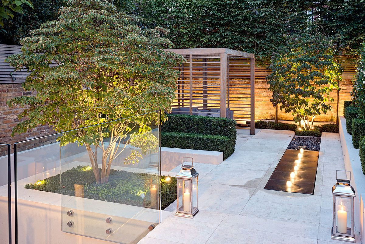 A romantic lit fountain softens this contemporary