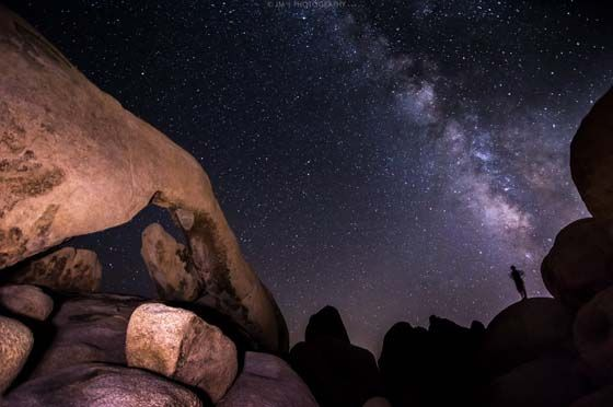 Joshua Tree (night scene showing the Milky Way galaxy over rock formations)