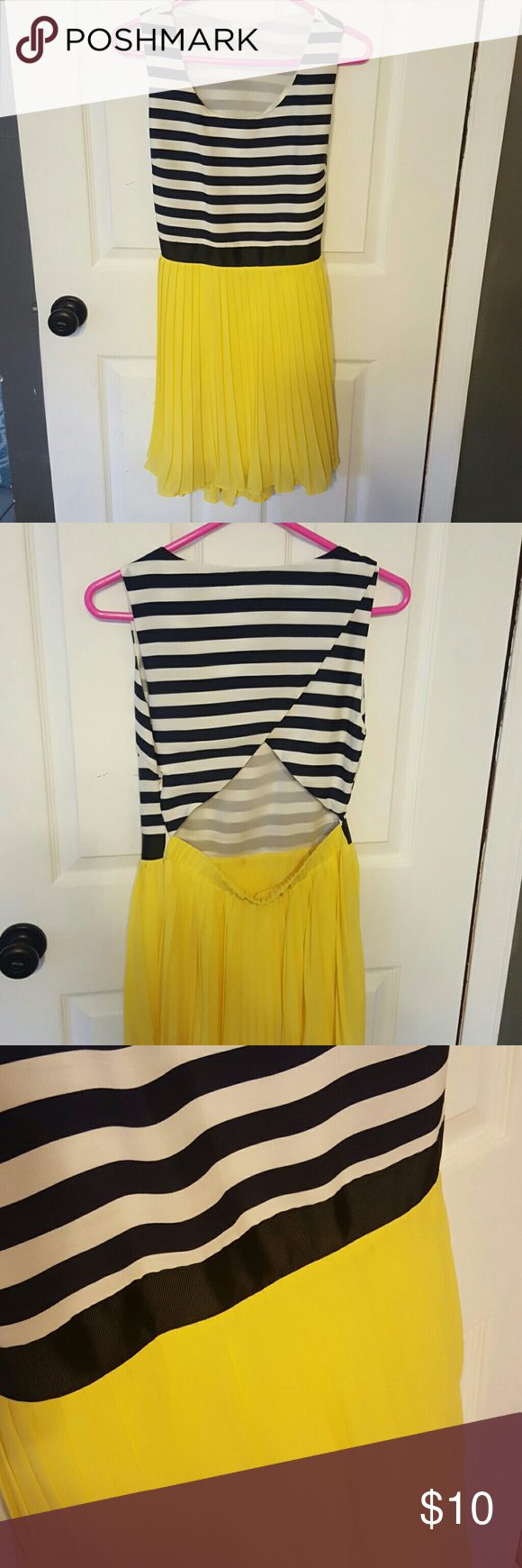 Gorgeous summer dress Navy stripes with yellow dress with gorgeous open back. Never worn. Bought it and never found a place to wear it to! Charming Charlie Dresses Midi