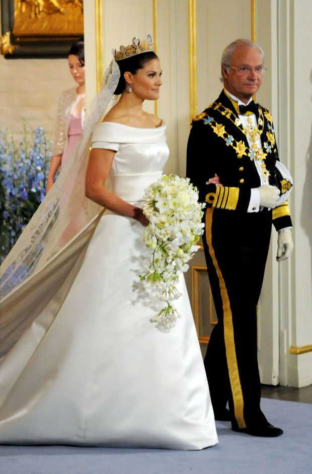 Crown Princess Victoria with her Father King Carl XVI Gustaf of Sweden on her wedding day June 2010