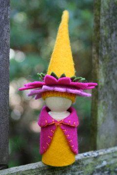Gnomo de Zinnia imperdible con su sombrero de flor amarillo magenta, rosa y oro vibrante como ella aclara encima de cada jardín o bouquet puede formar parte de!  Este sentido gnome está parado 5 de alto (12,5 cm) y está hecho de lana suave y acogedora de fieltro y bordado hilo hilo de algodón. Trabajo todo fieltro y bordado es cuidadosamente mano hecha a mano por mí. Simple me deleito en la fabricación de estos gnomos para la gente disfrutar. Firmar y fechar cada uno en la parte inferior de…