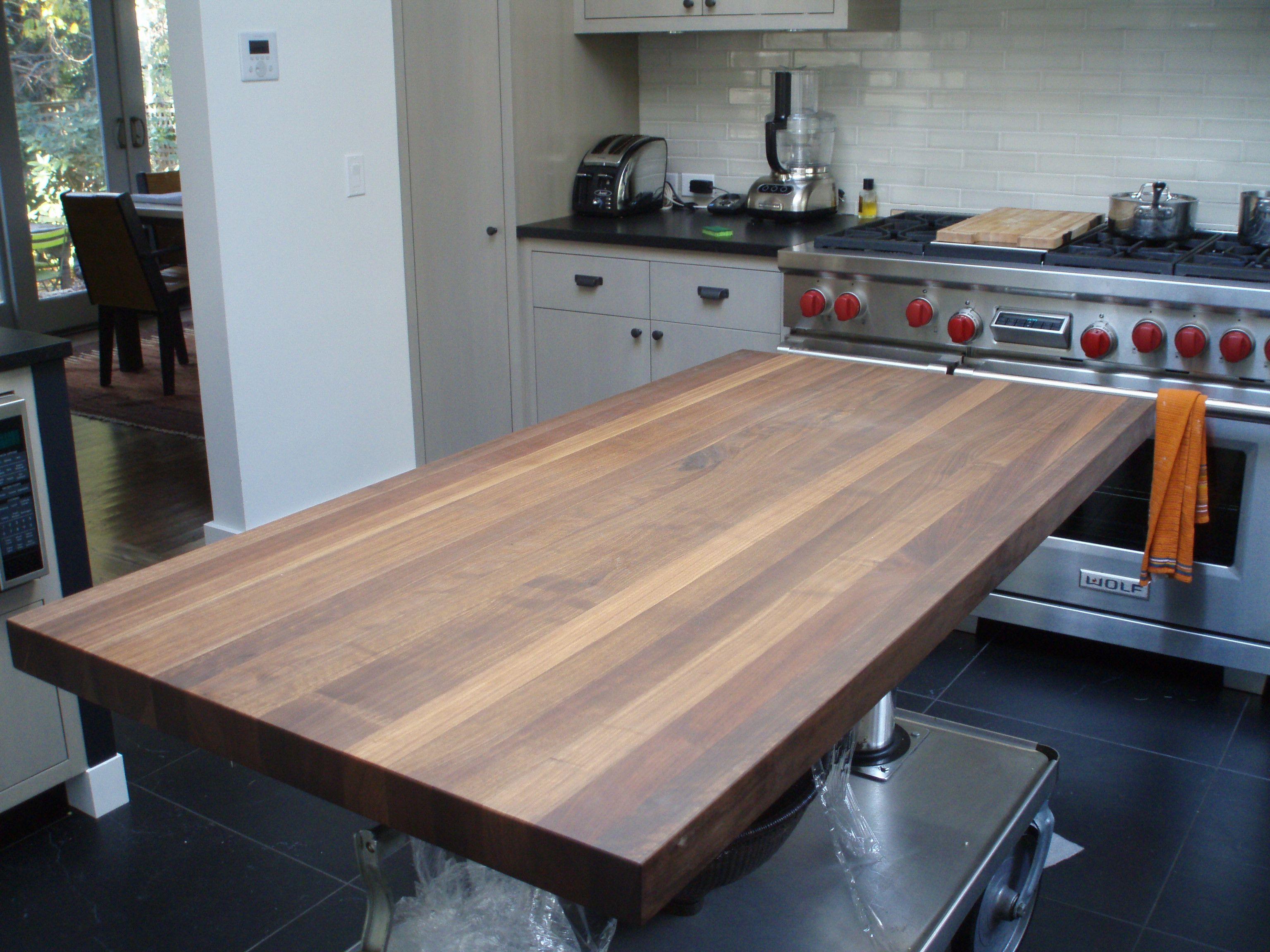 Standard Plank Walnut Island Countertop In A Transitional Kitchen
