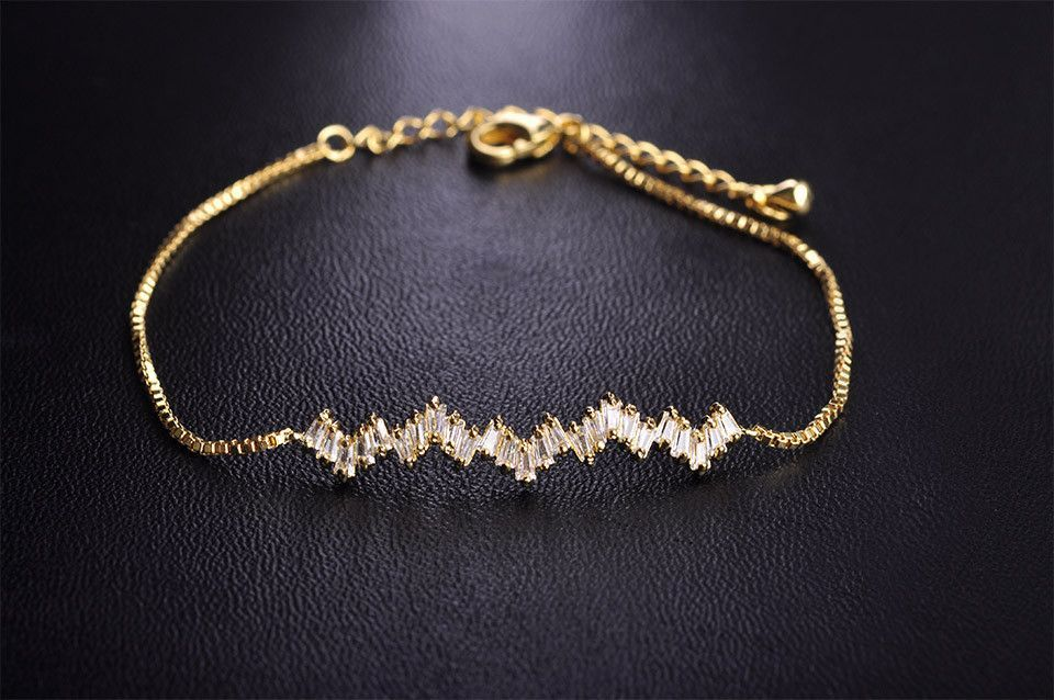 Jenner Wavy Gold Bar Bracelet $55.00 Shop Elegant Trendy Jewelry By Body Kandy Couture #bling #womensaccessories #stylista #weddingaccessories #bijoux