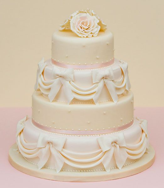Sarah Louise Cakes Romantic Four Tier Wedding Cake With Sugar Drapes And Bows