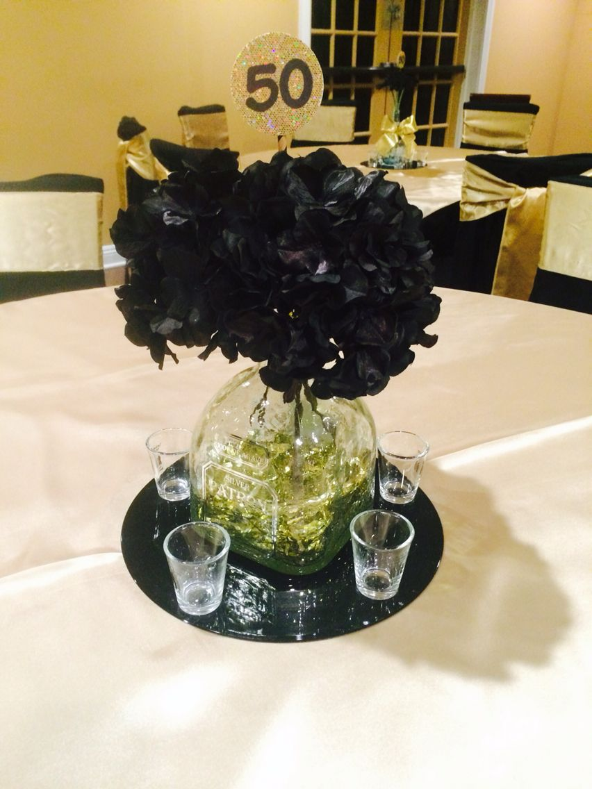 centerpiece made with old tequila bottles silk flowers metallic rh pinterest com