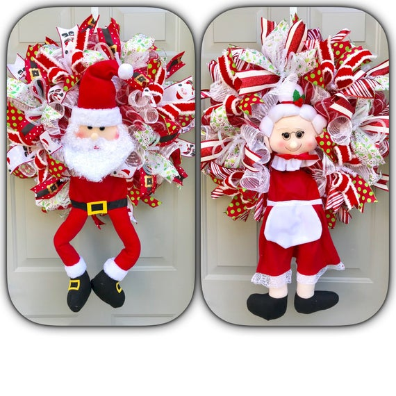 Santa and Mrs Claus Wreath for Double Doors, Santa Wreath, Christmas Wreath, Red and White Wreath, Santa Hat, Double Doors Wreaths #doubledoorwreaths Santa and Mrs Claus Wreath for Double Doors, Santa Wreath, Christmas Wreath, Red and White Wreath, Santa Hat, Double Doors Wreaths This listing is for a set of two Christmas wreaths that measure approximately 24x24x7 (plus the legs hanging down) each. You will receive one wreath with Santa Claus #doubledoorwreaths