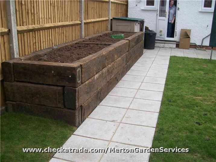Rubbish cleared, fences replaced, path laid, raised beds with old railway sleepers, turf laid and br