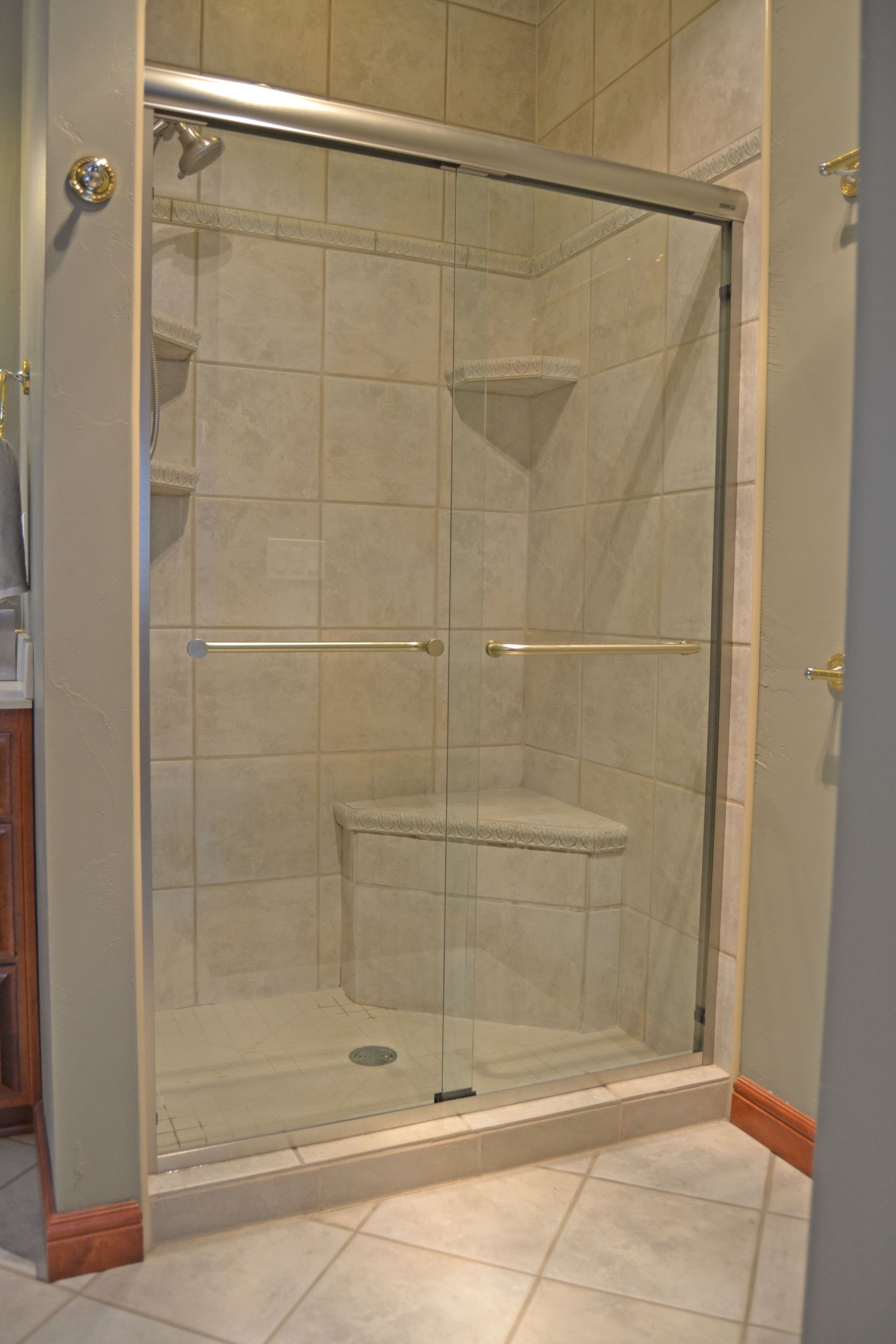 Tri City Glass \u0026 Door specializes in commercial glass projects and automotive glass repair and are your residential glass and door professionals. & Basco frameless sliding shower doors on a tiled opening. | Shower ...