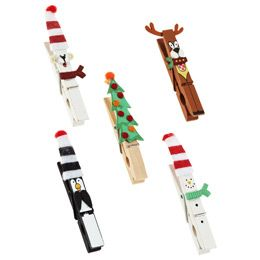 Add the perfect holiday touch to gift cards or packages with our Christmas Clothespins. You can even use them to create a display of cards or as part of a handmade craft. They are also perfect to attach a tag to a package. No matter how you use them, they'll add the perfect bit of holiday charm. #holidayclothes