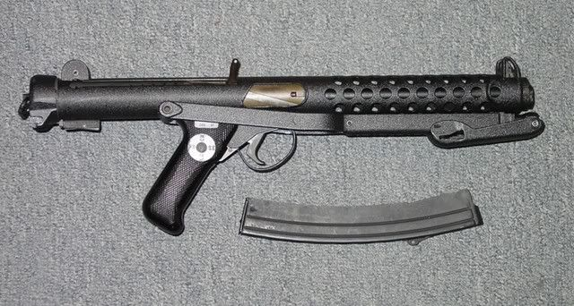 Sterling 9mm sub machine gun and curved magazine  | USEFULL