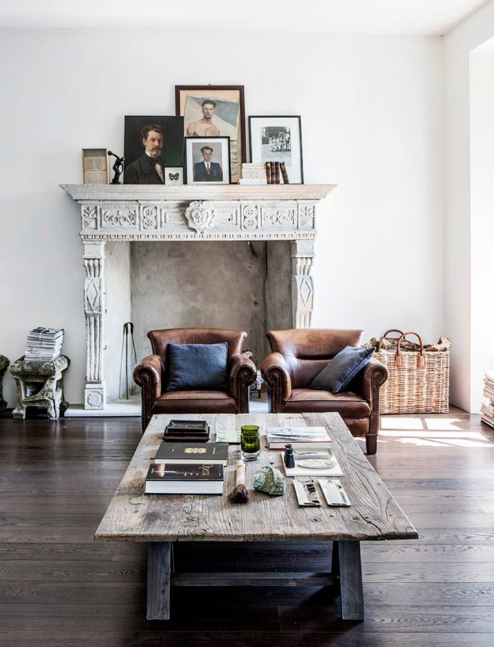 Dark wood flooring contrasts with the white
