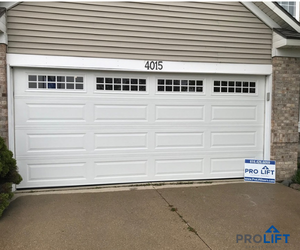 With A Long Panel Design And Windows With Grilles Garage Doors Garage Door Styles Steel Garage Doors