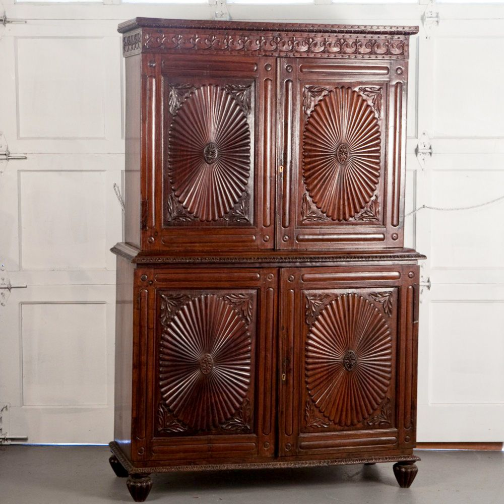 #AntiquesCabinet: Indo-Portuguese Rosewood Cabinet with Sunburst Doors Indo-Portuguese cabinet in solid rosewood with typical sunburst patterned carved doors and other carved details. Interior has single shelf on top and two shelves in bottom cabinet. http://www.mdantiques.com