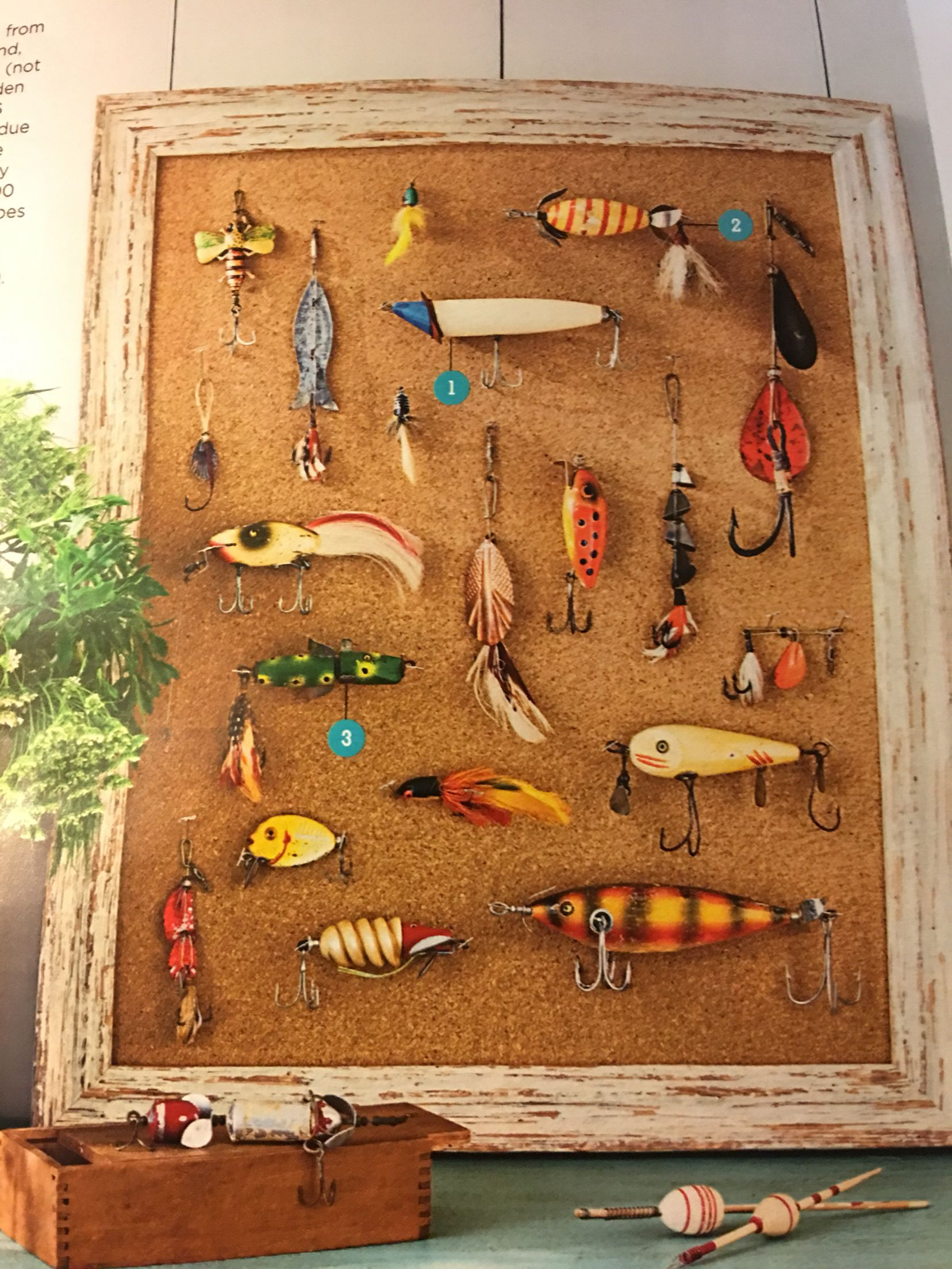Fishing lures in cork board in aged frame this would be